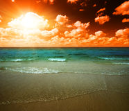 Sunset and tropical ocean Royalty Free Stock Images