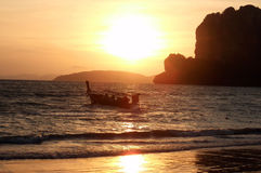 Sunset in tropical paradise. Sunset with boat on thailand beach island stock photos