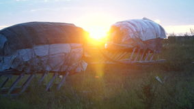 Sunset in the tundra. Sleds in the sunshine. Summer. The Yamal peninsula stock video footage