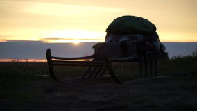 Sunset in the tundra. Sleds in the sunshine. Summer. The Yamal peninsula stock video