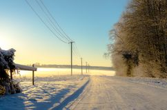 A countryside road in winter. Sunset in Turi, central Estonia, in January royalty free stock photography