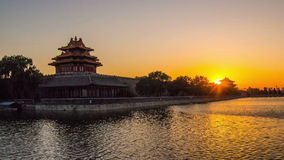 The sunset at the turret of Palace Museum. The sun goes down at the turret of Palace Museum, Beijing, China stock footage