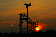 Sunset on TV Crew. The sun sets on a TV crew Royalty Free Stock Photo