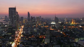 Sunset twilight bangkok cityscape traffic streets roof top panorama 4k time lapse thailand stock video