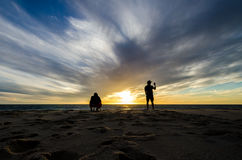 Sunset. Two men taking photot of the sunset Stock Images