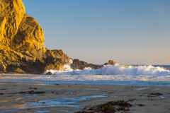 Sunset among two rocks at Pfeiffer State Park, Big Sur, Californ Royalty Free Stock Photos