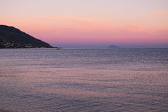 Sunset at the Tyrrhenian Sea. Houses are located on seacoast. Marina di Patti. Sicily Royalty Free Stock Images