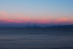 Sunset at the Tyrrhenian Sea. Islands on the horizon. Marina di Patti. Sicily Royalty Free Stock Photo
