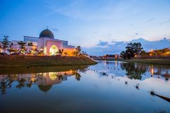 BeautifulSunset at UIAM Mosque. Sunset at uiam mosque with reflection on the lake surface stock photo