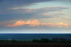 Sunset in Ukraine. Cumulus clouds against the setting sun Stock Images