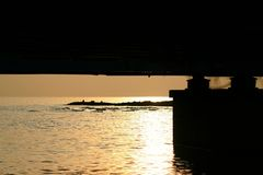 Sunset under the bridge Royalty Free Stock Images