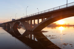 The sunset under the bridge Royalty Free Stock Image