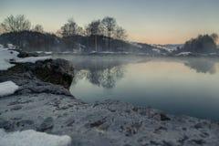 Sunset under calm lake stock images