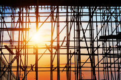 Sunset under the construction site. In China Royalty Free Stock Images