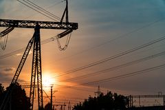 Sunset under the high-voltage tower in the background. stock images