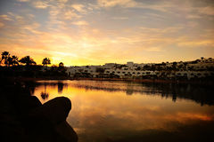 Sunset under hotel. Sunset and its reflection in water, Egypt, Coral bay hotel Royalty Free Stock Photos