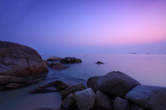 Sunset under long exposure along seashore. It is a natural composition under long exposure in Hong Kong. We can find sea rocks and water frozen Royalty Free Stock Photography