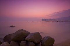 Sunset under long exposure along seashore Royalty Free Stock Photography