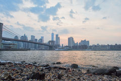 Sunset under manhattan bridge in new york Stock Image