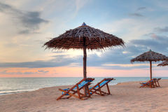 Sunset under parasols on the beach Stock Image