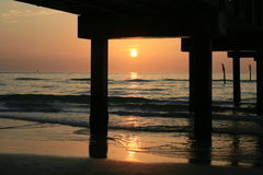 Sunset Under The Pier Royalty Free Stock Photos