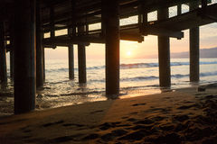 Sunset from Under the Pier. The sun setting from underneath the Santa Monica Pier Stock Photography