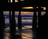 Sunset under a pier Stock Photography