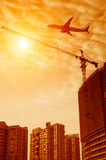 Sunset under the site tower crane. Sunset on the construction site tower crane work stock image