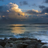 Sunset under storm clouds on the Dorset Coast Royalty Free Stock Image