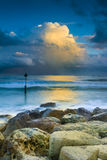 Sunset under storm clouds on the Dorset Coast Royalty Free Stock Photo