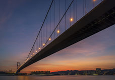 Sunset under the Tsing Ma Bridge of Hong Kong. Royalty Free Stock Photography