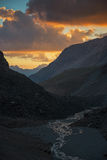 Sunset under valley in high mountains Stock Image