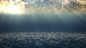 Sunset under water. Sunset rays of the sun make their way under the water. The camera moves under the surface of the water stock video footage