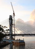 Sunset on unfinished bridge in Manado stock photo