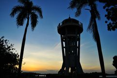 Sunset at Upper Seletar Reservoir. Singapore. A tower shown in the photo is observation tower, in which people can go in and up to view the scenery from the Royalty Free Stock Photography
