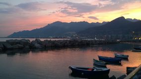 Sunset. Urban landscape and the sea lugomere of Salerno headquarters from time tourism stock photography