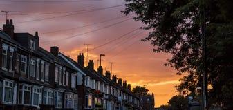 Sunset on urban street stock images