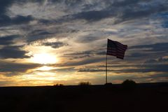 Sunset Flag. Sunset with the USA flag waving Royalty Free Stock Images