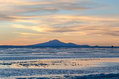 Sunset at Uyuni Salt Flats in Bolivia, the incredible salt desert in South America. Scenic sunset at Salar de Uyuni, Uyuni Salt Flats in Bolivia, the incredible stock photography