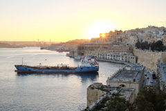 Sunset in Valleta, Malta. Old harbour at sunset with overview of. The city Stock Photography