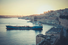 Sunset in Valleta, Malta. Old harbour at sunset with overview of. The city. Artistic effect applied Royalty Free Stock Photo