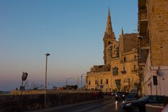 Sunset in Valletta, Malta. VALLETTA, MALTA - AUGUST 21, 2017: Valletta the beautiful capital city of Malta is visited daily by crowds of tourists. Sunset lights Stock Images