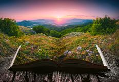 Sunset in a valley on the pages of an open book Royalty Free Stock Photography