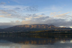 Sunset on the Varese lake. Last rays of sun on the mountains with reflection royalty free stock images