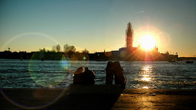 Sunset in Venezia. A couple lookng at the sunset Stock Photography
