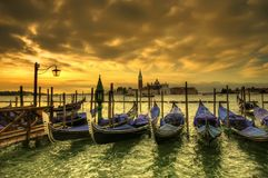Sunset in Venice. Venice dramatic scene with gondolas at sunset, Italy Royalty Free Stock Photos