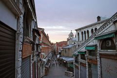 Sunset in Venice. Closed shopping street at sunset from the Rialto Bridge in Venice Royalty Free Stock Images