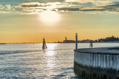 Sunset on Venice lagoon in Italy Stock Images