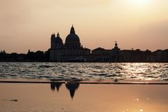 Sunset in Venice - Reflection of the Madonna della Salute church Royalty Free Stock Image