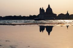 Sunset in Venice - Reflection of the Madonna della Salute church Royalty Free Stock Images